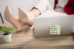 Female legs near laptop Stock Photo