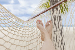 Free Female Legs On Hammock On Tropical Beach With Palm Leaf Thatch Roofing Umbrellas And Palm Trees In The Background Stock Photography - 89008452