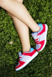Female legs over the grass Stock Photography