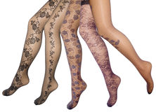 Female legs in pantyhose. Female legs in transparent pantyhose different patterns royalty free stock photos