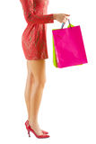 Isolated female legs and paperbags Royalty Free Stock Photos