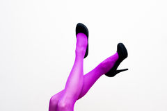 Female legs in pink pantyhose and black high heels Royalty Free Stock Photos