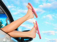 Female legs in pink sandals. Out from the car. Summer trip concept Stock Photography