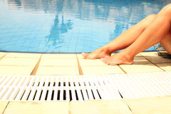 Female legs in the pool water Royalty Free Stock Image