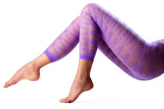 Female legs in purple leggings Royalty Free Stock Photo