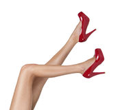 Female legs with red high heels Royalty Free Stock Photography
