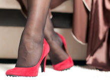 Female legs in red shoes Royalty Free Stock Photography