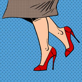 Female legs in red shoes woman coat goes pop art Royalty Free Stock Photography