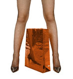Female legs and red shopping bag Stock Photo
