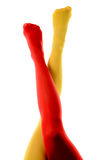 Female legs with red and yellow tights Royalty Free Stock Image