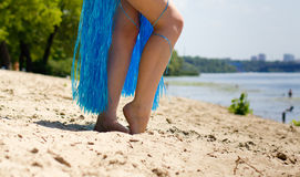 Female legs on a river background Stock Photo