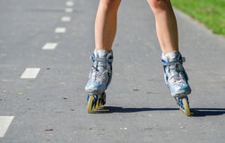 Female legs in roller blades Stock Photo