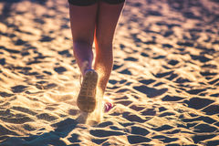 Female legs in sand Royalty Free Stock Photography