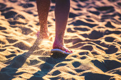 Female legs in sand Royalty Free Stock Image