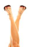 Female legs in sandals Stock Image