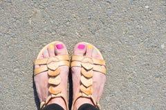 Female legs in sandals Stock Photo