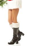 Female legs in santa boots Stock Image