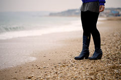 Female legs at the seaside Royalty Free Stock Image
