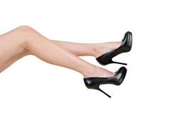 Female legs. In shoes isolated on white background Stock Photos