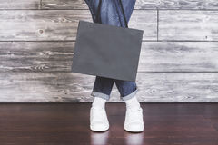 Female legs with shopping bag Royalty Free Stock Photos