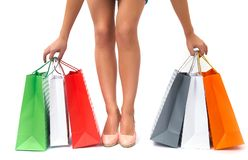 Female legs with shopping bags Stock Images