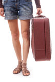 Female legs in shorts and suitcase in hand. Isolated on white background Stock Photography