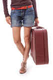 Female legs in shorts and suitcase in hand Stock Photos