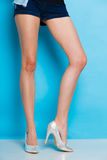 Female legs in silver high heels shoes Stock Photography