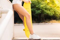 Female legs with skateboard Stock Photos