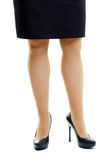 Female legs in skirt and high heels. isolated Royalty Free Stock Image