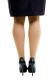 Female legs in skirt and high heels. isolated Stock Photo
