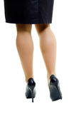 Female legs in skirt and high heels. isolated Stock Photos