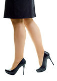 Female legs in skirt and high heels. isolated Royalty Free Stock Images