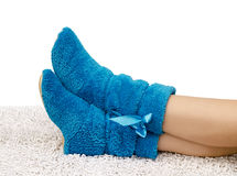 Female legs in slippers Stock Images