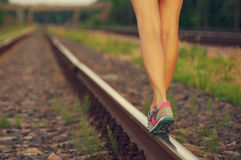 Female legs in sneakers on the railway tracks Royalty Free Stock Photography