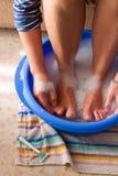 Female legs in soap bath stock image