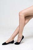 Female legs in socks.  on a Grey  background Stock Photography