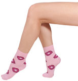 Female legs in socks. Isolated on white background. Stock Image