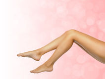 Female legs on spa background Royalty Free Stock Photos