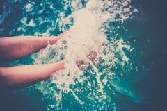 Female legs splashing sea water Royalty Free Stock Images