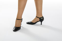 Female legs stand in dance pose Stock Photo
