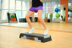 Female legs on the step board during exercise Stock Image
