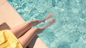 Female legs in swimming pool. Top view of clear water. Forget problems and enjoy summer stock video