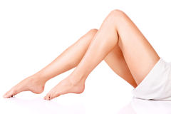 Female legs and towel Royalty Free Stock Photo