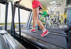 Female legs on a treadmill Stock Image