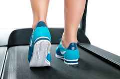 Female legs in turquoise sneakers on a treadmill Royalty Free Stock Photography