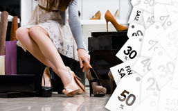 Female legs and variety of shoes. Clearance sale royalty free stock photos