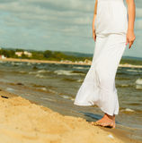 Female legs walking on beach, summertime Stock Photo