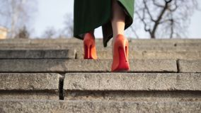Female legs walking upstairs on stone staircase stock footage