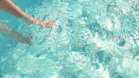 Female legs in water. stock video